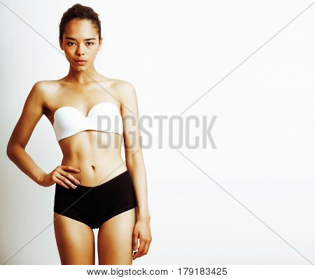 young pretty african american woman close up isolated on white background, asian mulatto tanned nude makeup, lifestyle spa real beauty people concept sport close up
