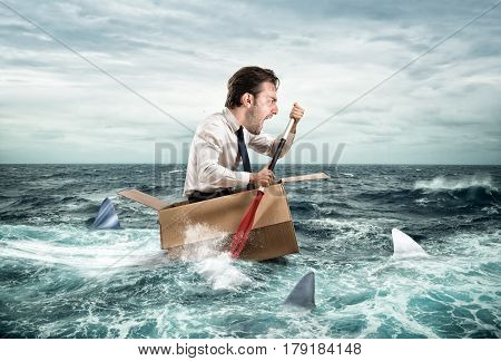 Fearful Businessman escapes screaming from sharks on a cardboard. Funny face