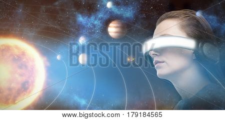 Low angle view of woman trying virtual reality against graphic image of various planets with sun 3d