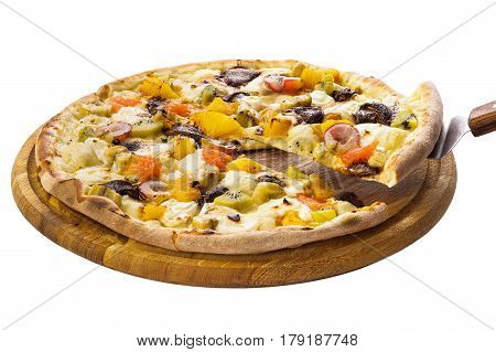 Pizza with fruit filling the segment is raised on the scapula