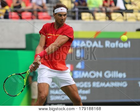 RIO DE JANEIRO, BRAZIL - AUGUST 11, 2016: Olympic champion Rafael Nadal of Spain in action during men's singles round four match of the Rio 2016 Olympic Games at the Olympic Tennis Centre