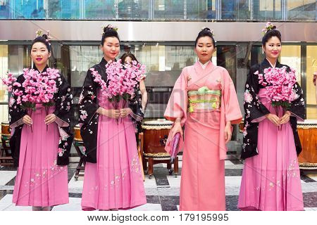 Moscow, Russia - March 24, 2017: Group Of Japanese Geisha Girls Dancing In Traditional Kimono In Riv