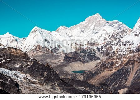 Mountain Landscape panoramic View of snowcapped sharp Summits and Ridges deserted Nature of rocky Valleys and Lake in the Middle of Composition