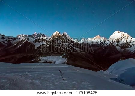 Night View of Mountain Panorama Glacier and Snow on foreground severe range of Summits and starry Sky on Background