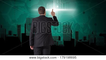 Digital composite of Businessman touching pointing interface on City with world map