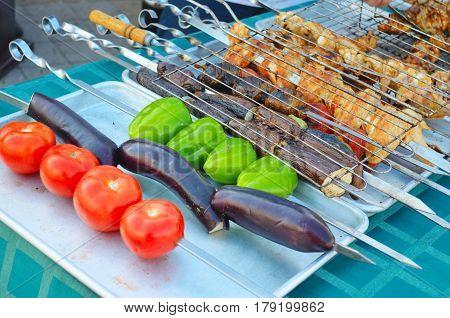 Vegetables and meat grilled kebabs on skewers