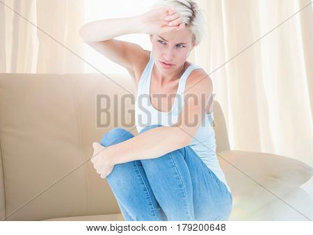 Digital composite of Sad distressed afraid woman crouched near window light