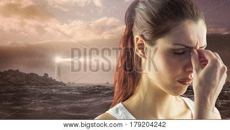 Digital composite of Sad stressed woman next to hopeful lighthouse