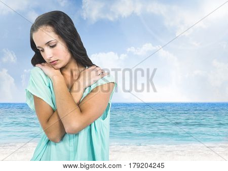 Digital composite of Sad young woman against beach sea