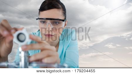 Digital composite of Close up of woman with electronics against sky