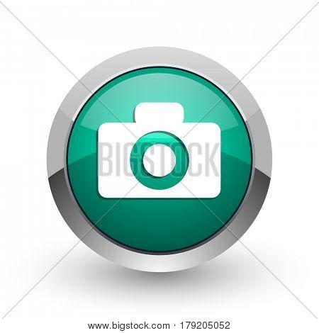 Camera silver metallic chrome web design green round internet icon with shadow on white background.