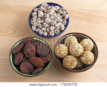 Oriental sweets in bowls on a table