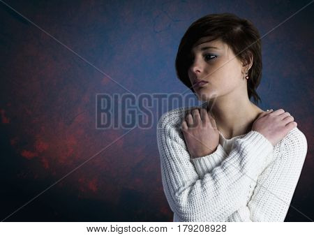 Digital composite of Sad young woman grief against blue background