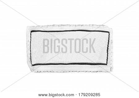 Blank white clothes label isolated over white