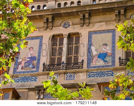 PALMA DE MALLORCA BALEARIC ISLANDS SPAIN - SEPTEMBER 5 2007: Facade of the building with a mosaic picture on external wall in Palma De Mallorca Balearic Islands Spain on September 5 2007.