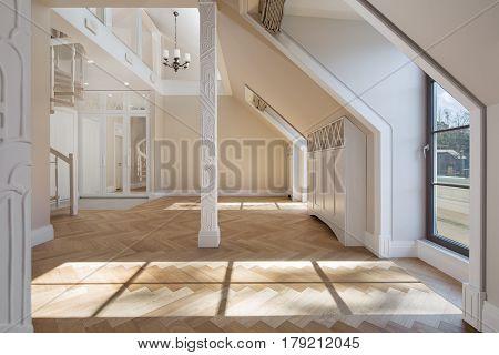 Interior of new designer apartment with big windows