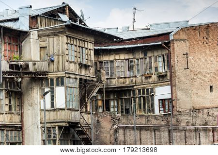 Dilapidated House With Skewed Balconies