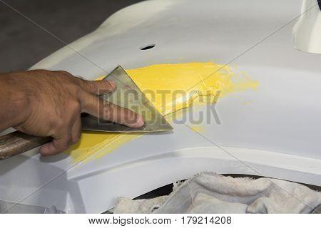 Plastering body car at automobile repair before painting body