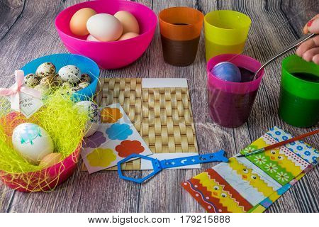 colored Easter egg decorated on the table in the holiday of light Christ is Risen in different colors