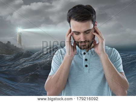 Digital composite of Stressed upset man next to hopeful lighthouse