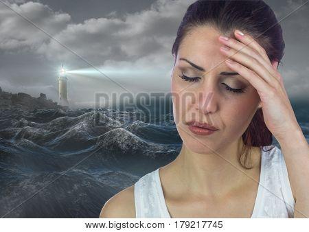 Digital composite of Stressed upset woman next to hopeful lighthouse