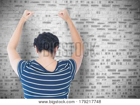 Digital composite of Sad angry woman grief banging fists against a wall