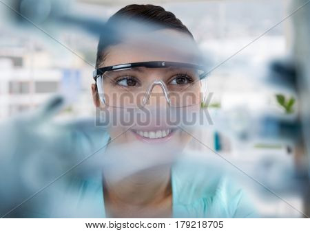 Digital composite of Close up of woman through electronics in office