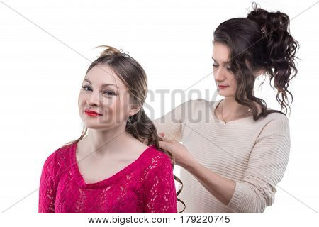 Working hairstylist and smiling client on white background