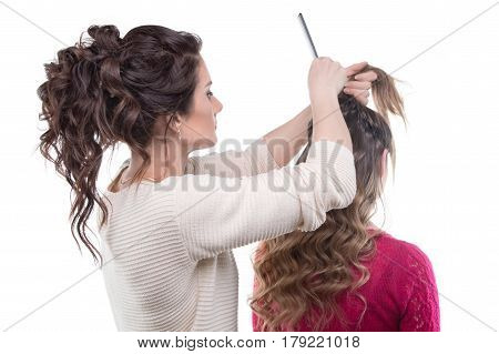 Woman from back and hairstylist with hairbrush on white background