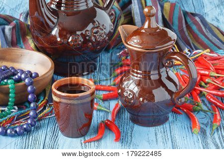 Several Ceramic Pots And Jars On A Table
