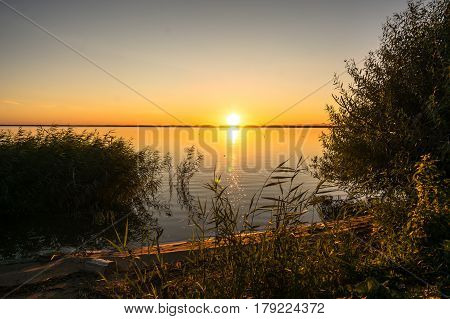 Beautiful Evening Landscape With Lake, Silhouette Tree And Bushes During Sunset.bhopal India