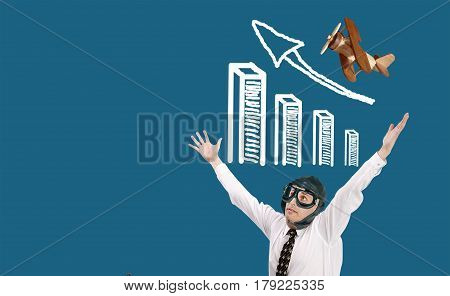 Surprised businessman aviator and growing financial profit graph