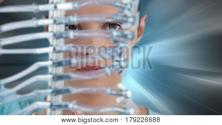 Digital composite of Close up of woman through electronics against blue motion blur