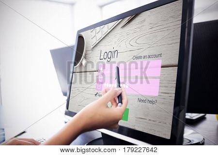 Close-up of login page against casual businesswoman touching her computer Casual businesswoman touching her computer with a pen