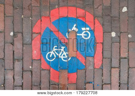 No cycling sign painted on a pavement.