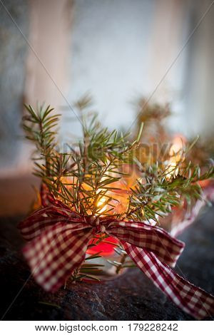 Christmas candles with pine branches and ribbon