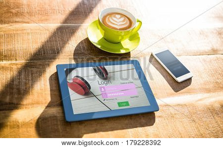 Close-up of login page against cup of coffee and tablet pc