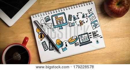 Digital generated image of various business icons against overhead of notepad and pen
