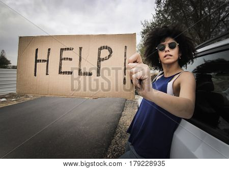 Woman Traveling Alone Holding Help Sign