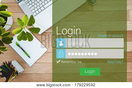 Close-up of login page against business desk with laptop and colors pencil