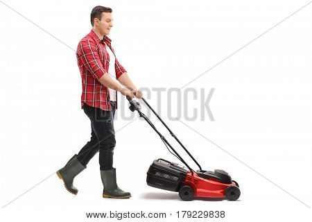 Full length profile shot of a gardener mowing with a lawnmower isolated on white background