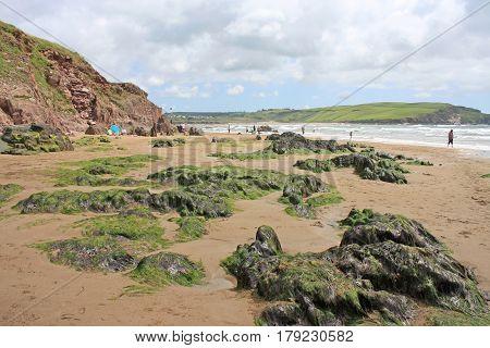 Rocks on Bigbury beach at low tide