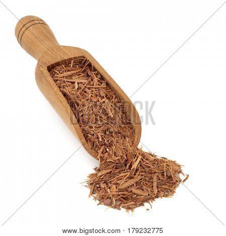 Catuaba bark brazillian herbal medicine in a wooden scoop over white background. Used in alternative  medicine as an aphrodisiac.