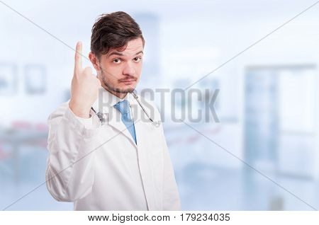 Young Male Doctor Rising Up One Finger