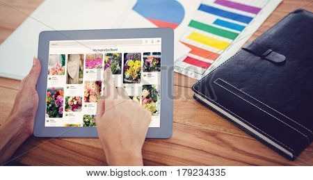 Composite image of website page against over shoulder view of hipster woman using tablet