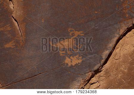 Ancient Petroglyphs calven into a rock facce in Utah, USA