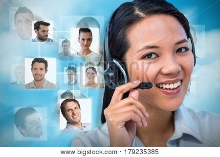 Smiling businesswoman using headset against blue background