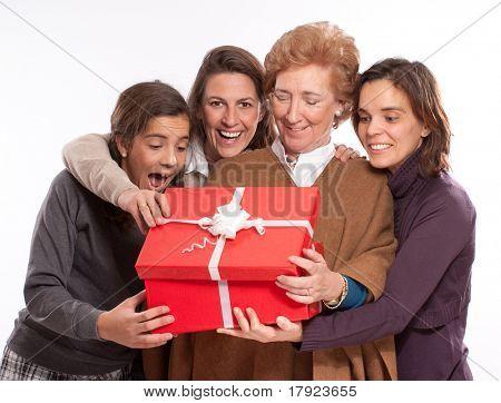 Family women in raptures over an open giftbox