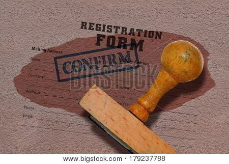 Registration form and a wooden stamp on grunge background