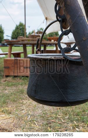 Black Pettle Hung on Tree Trunk Wooden Table in background